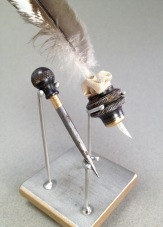"""""""Measure and Mark"""" Stainless steel, found tool parts, enamel, feather, silk. 2016"""