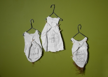 """""""Rules of Poetry"""" Interior. Forged iron, human hair, child's dresses. 2003"""